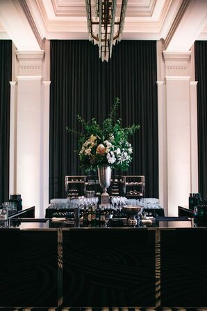 Black Art Deco Bar with Oversized Vase of Greenery and Flowers