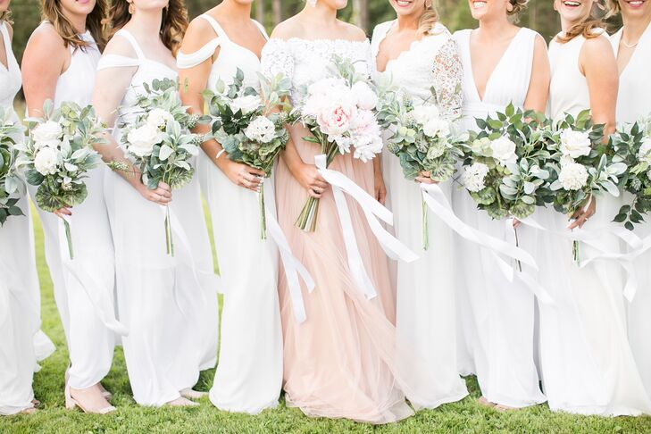 """I love, love, love white—and all neutral colors really. I wanted the (bridesmaid) dresses to look crisp and clean, and I didn't want to stand out too much, so white was the best choice,"" Julie says. She also opted for silk flower bouquets, a move that cushioned the day's budget."