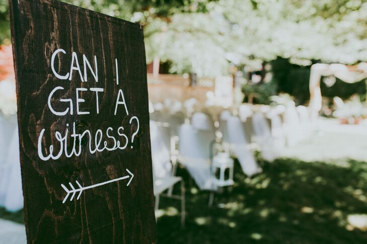 Rebecca and Judson's DIY projects for the wedding day included hand-painted wooden signs that directed guests to the ceremony and reception.