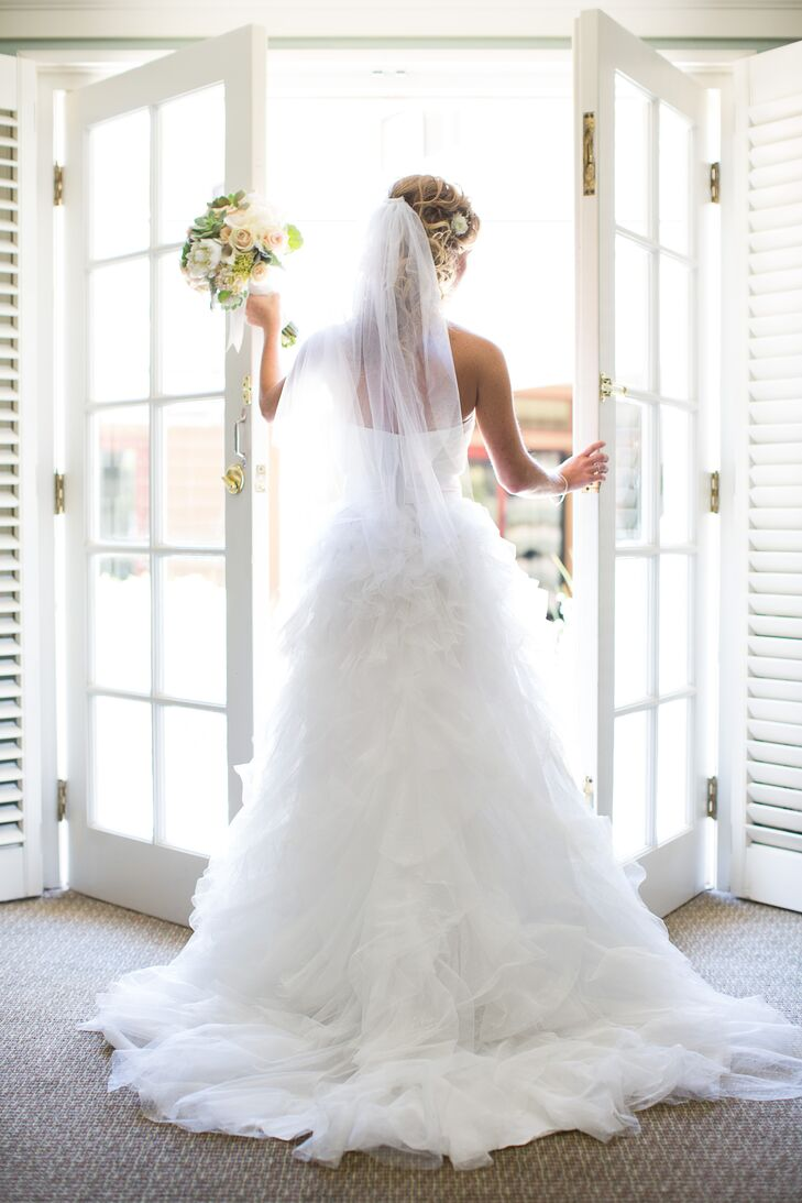 After trying on only a few other dresses, Brooke put on a strapless white dress with a ruffled skirt and sweetheart neckline. She fell in love with the dotted tulle pattern and simple bodice, embodying an elegant look for the classic occasion.