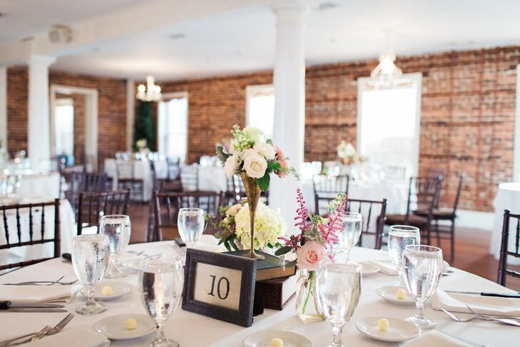 Wanting to highlight The White Room's exposed brick walls and vintage furniture, the couple decorated their reception with simple white linens, black chiavari chairs and unique vintage-inspired centerpieces designed by their florist,  Jade Violet Wedding and Event Floral Boutique.