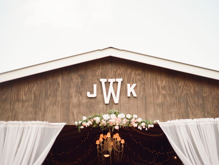 After the chapel ceremony at Cross Creek Ranch in Dover, Florida, the reception moved to the stable, which featured this monogram sign detail.