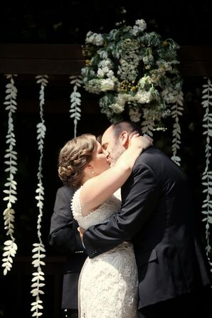 Sweet First Kiss Between Bride and Groom