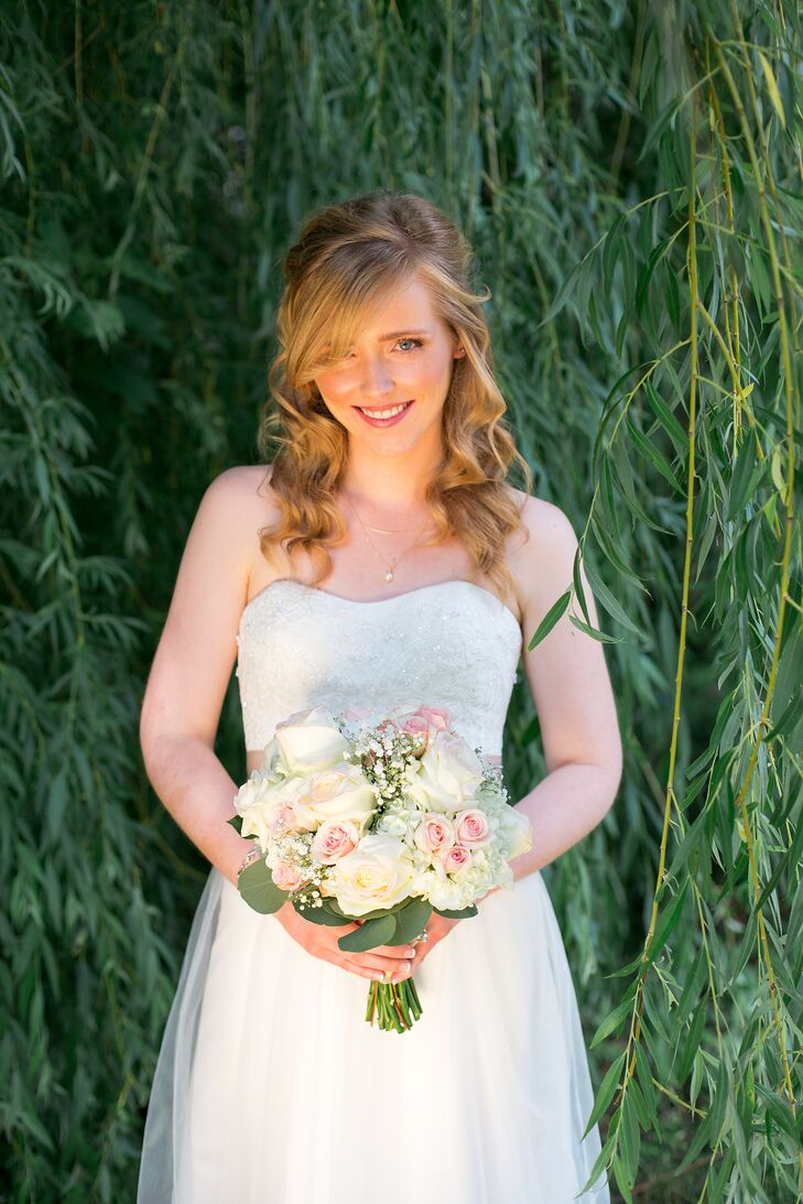 Katelyn found her A-line strapless gown with beaded bodice at David's Bridal.