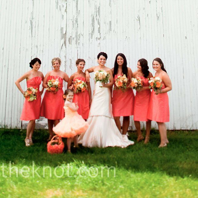 All six bridesmaids wore matching silk shantung dresses with crumb-catcher bodices to complement the pleats in Alison's dress.