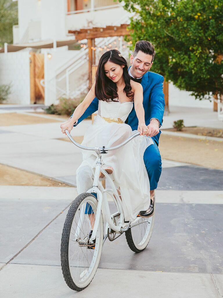 Couple leaving wedding on a bike