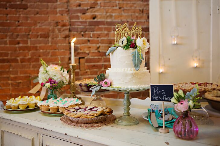 For dessert, Alexis and Andrew wanted to go beyond the standard wedding cake. To fit with dinner's relaxed and interactive vibe, the couple served dessert buffet style, inviting guests to indulge in several delicious sweet treats. In addition to a two-tier buttercream-frosted cake, there were also three flavors of mini cupcakes, five homemade pies, brownies, fruit crisps, candy and many of the couple's favorite sweets.