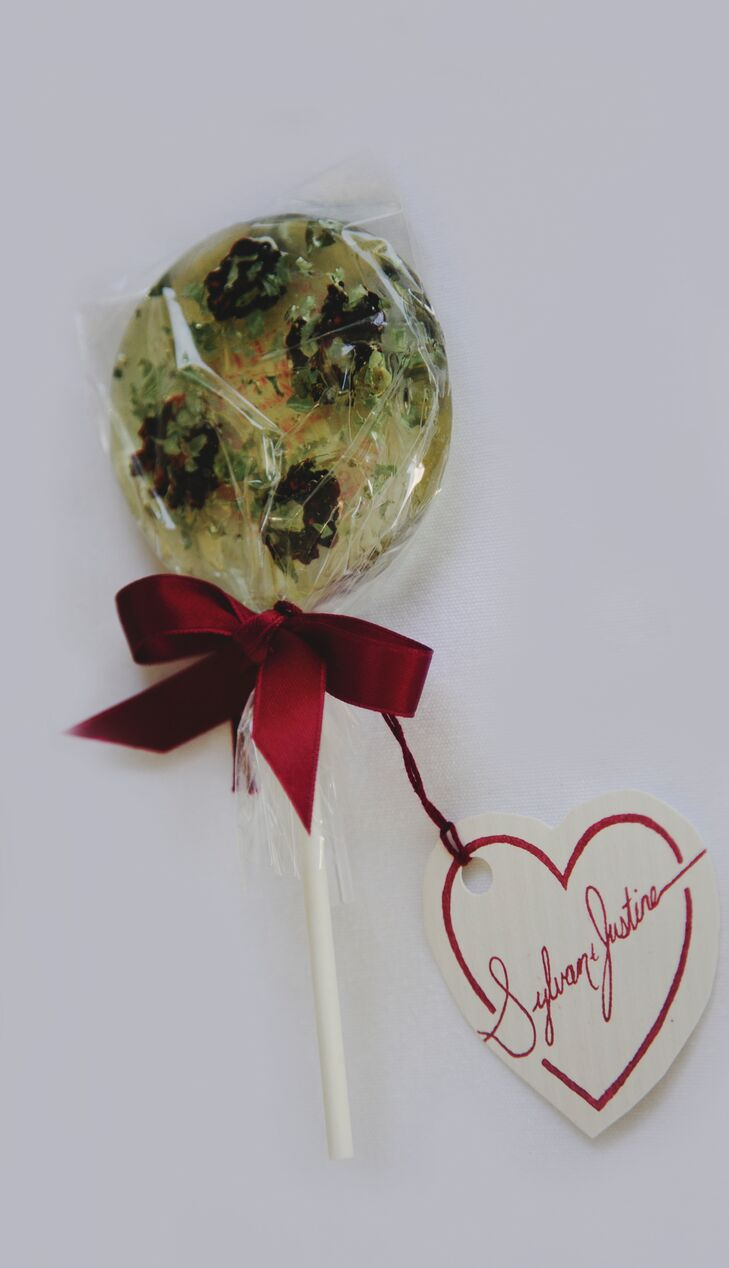 Wedding favors were artisanal lollipops from Etsy vendor A Secret Forest Patisserie. The lollipops were made with blackberries, jasmine and basil leaves.