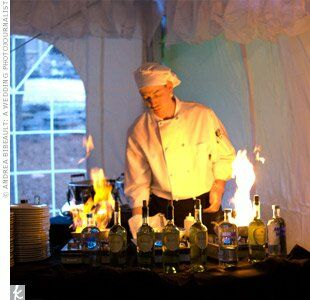Flames soared as the chef prepared a pasta dinner for the guests, warming up the lofty tent on a brisk spring evening.