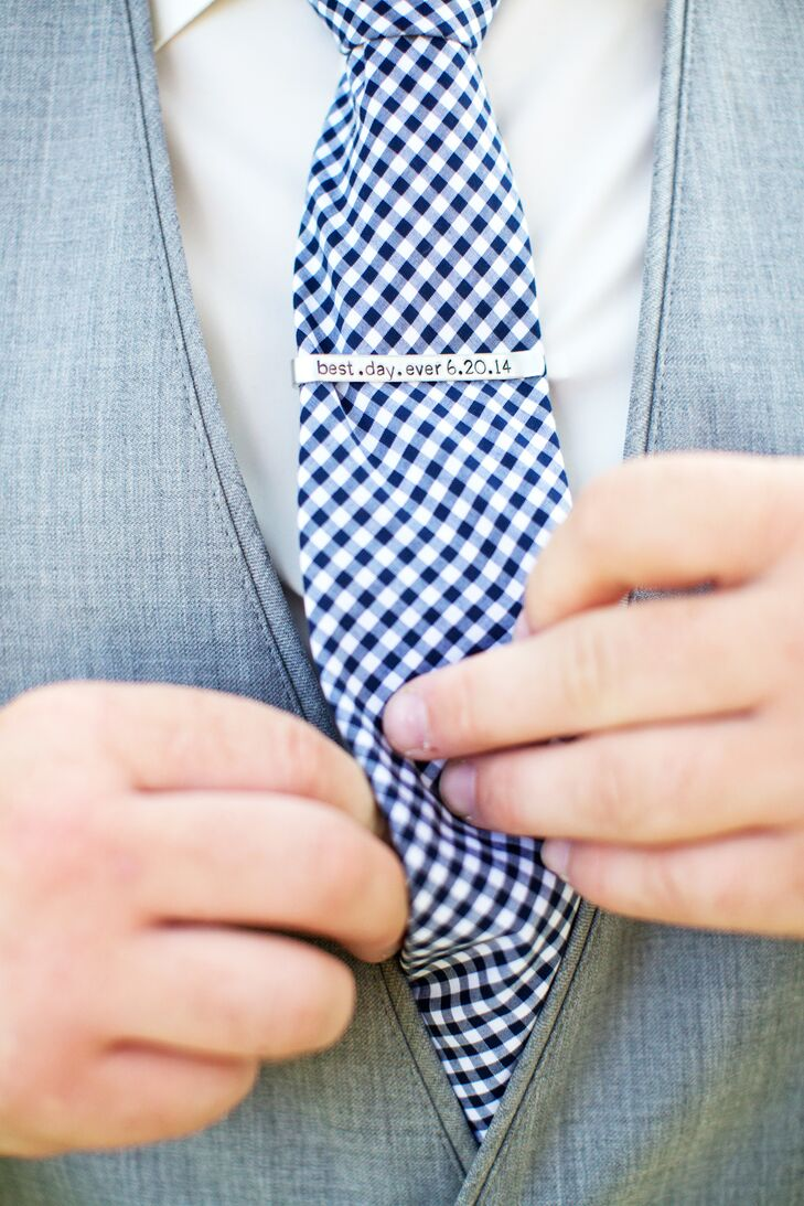Will wore a custom-engraved tie bar with a navy-and-white gingham tie.