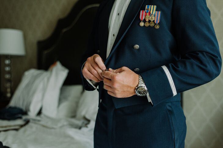 Jonathon, an officer in the Air Force, wore his navy military attire, while his groomsmen wore navy-colored Tommy Hilfiger suits and bow ties.