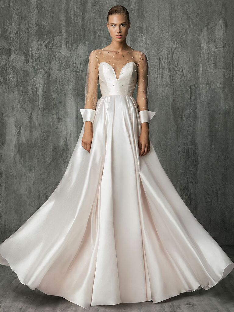 Victoria Kyriakides Fall 2018 wedding dresses with a tulle bodice covered in floating pearls