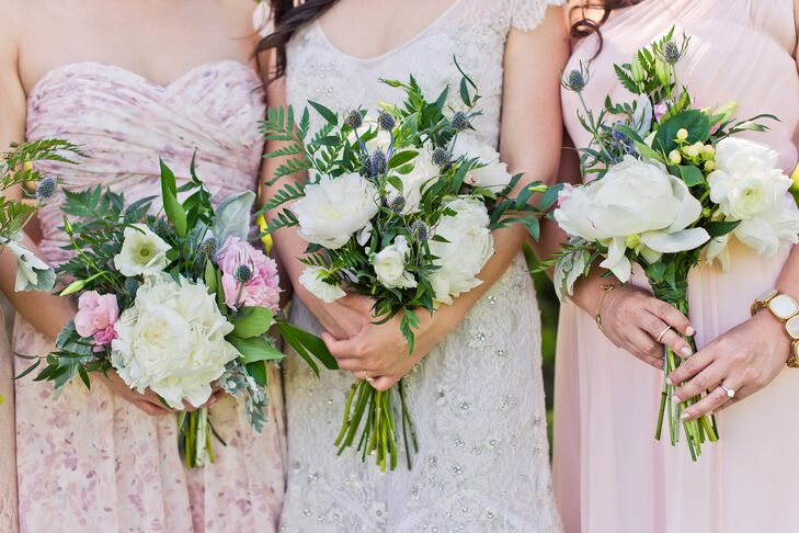 """When an Ann Arbor farmer found out Jo and Tom were planning their wedding, she generously invited the couple to take what they needed from her farm. """"She had been providing our businesses with fresh blooms for several years,"""" Jo says. """"My bridesmaids and I had so much fun putting together our own bouquets and making boutonnieres for the guys."""""""