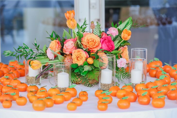 Tropical Flower Arrangement, Candles and Escort Cards with Oranges