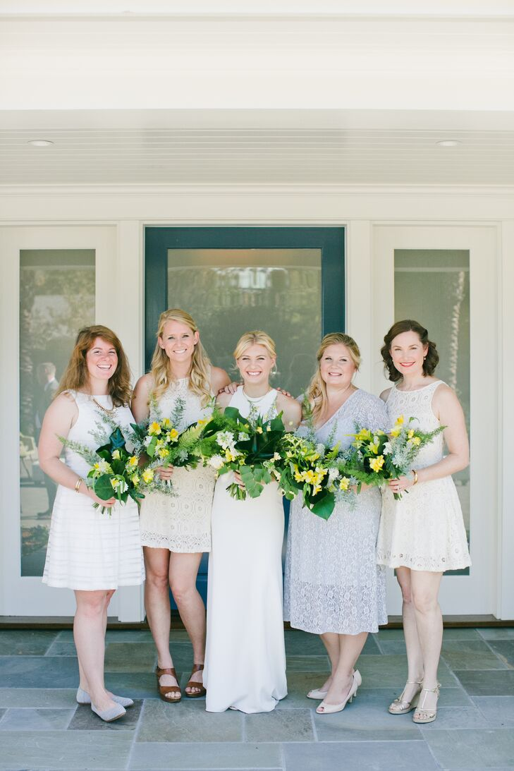 Carolyn's bridesmaids donned ivory and subtle gray-blue gowns of varying style. Delicate lace was a common thread that drew them together.