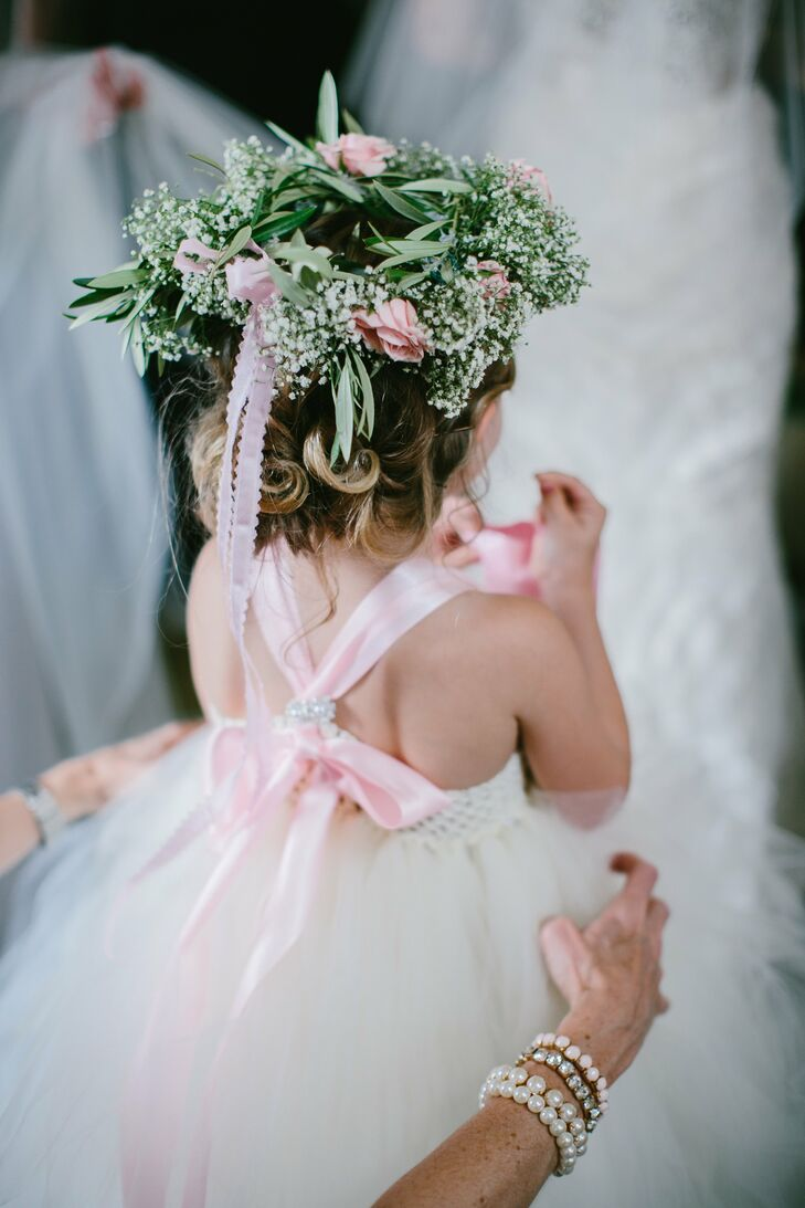 The flower girl wore a tulle dress with a lush flower crown.