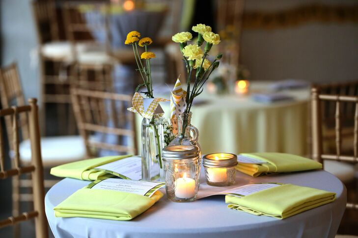 Simple centerpieces made from vintage glass bottles, pinwheels and yellow blooms topped guest tables. Small votives in Mason jars added a soft glow to the space.