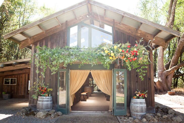 After the outdoor ceremony, guests picked up handcrafted beers and cocktails from the bar in this rustic structure—which sported an overhanging trellis that blossomed with all the right colors.