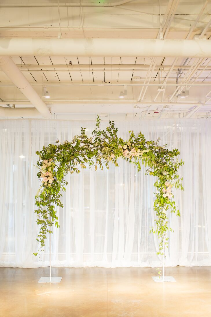 Simple Ceremony Arch with Flowers and Greenery