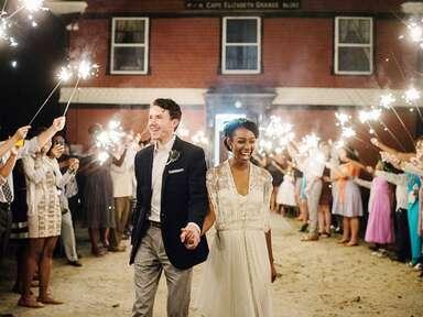 Bride and groom exiting wedding reception