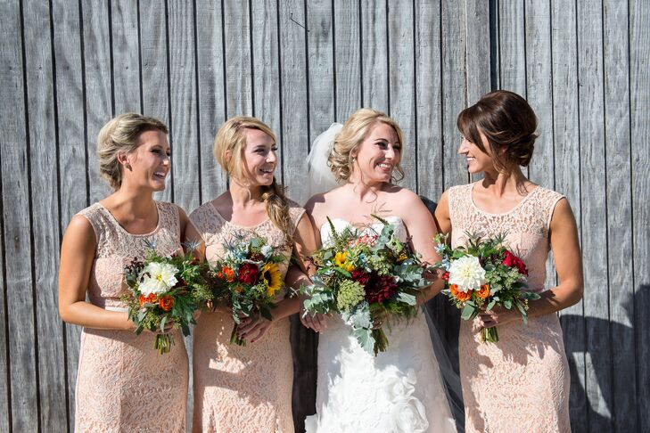 The bride's youngest sister wore this apricot lace gown for prom, and Lauren loved it so much that she had her other two bridesmaids buy the same one for the wedding attire.