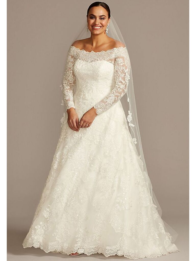 Lace ball gown with off-the-shoulder neckline and long sleeves