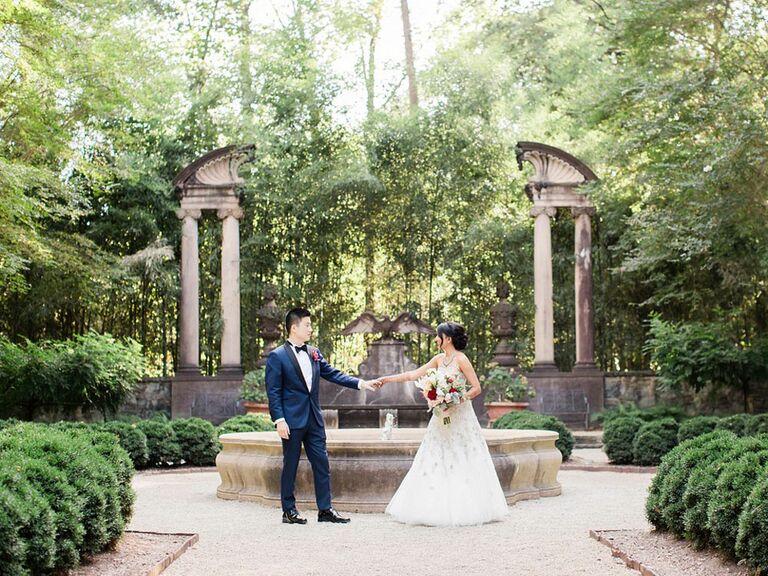 Bride and groom posting in magical secret garden wedding venue