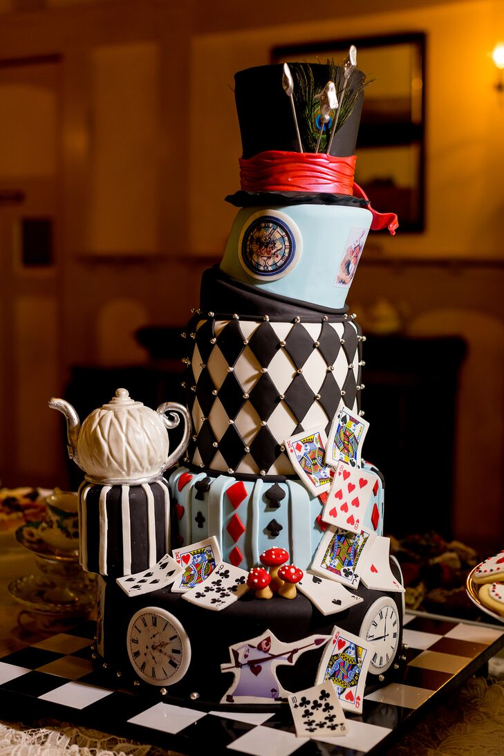 Artistic Desserts pulled out all the stops for Kelly and Richard's wedding cake, designing a five-tiered confection that perfectly captured the Alice in Wonderland theme. Tea pots, playing cards and even a top hat were incorporated into the design and as a finishing touch, the cake was displayed atop a black-and-white checkerboard.