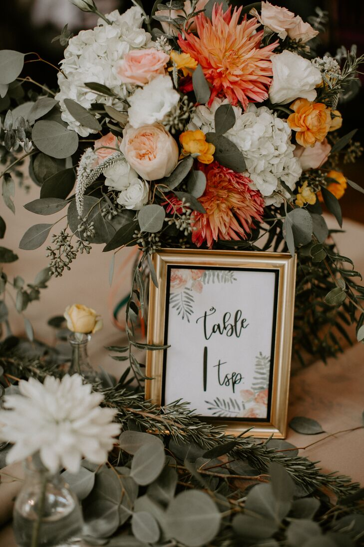 Gold Framed Table Number with Bright Proteas, Peonies and Eucalyptus