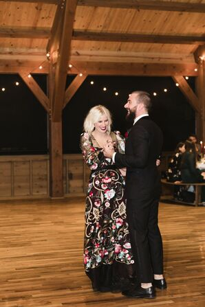 Alternative First Dance with Black Suit and Black Patterned Wedding Dress
