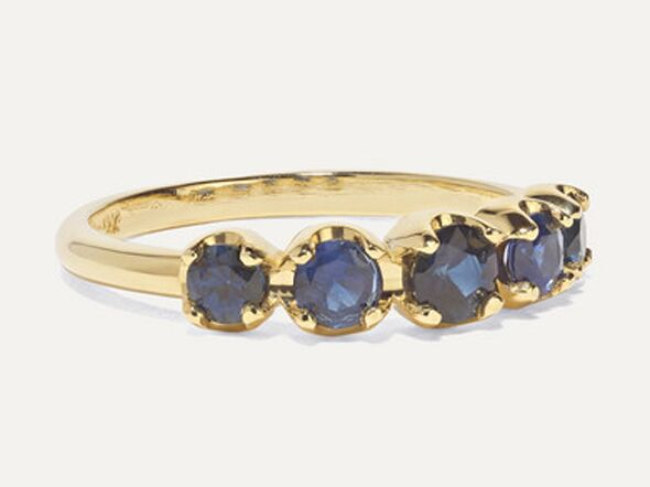 Sapphire engagement ring on gold band