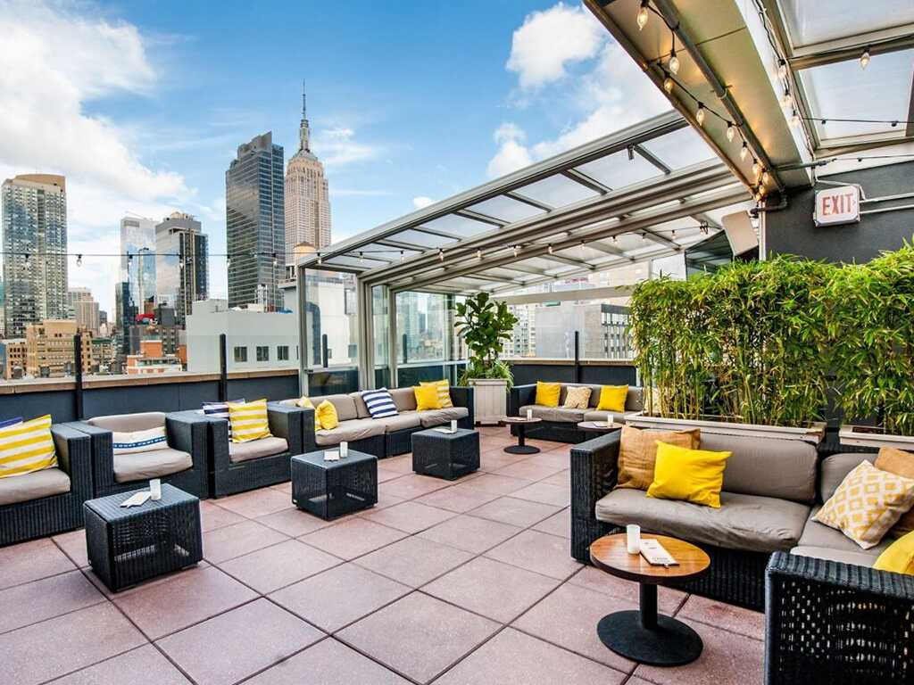 View of outdoor patio at rare view and surrounding buildings.