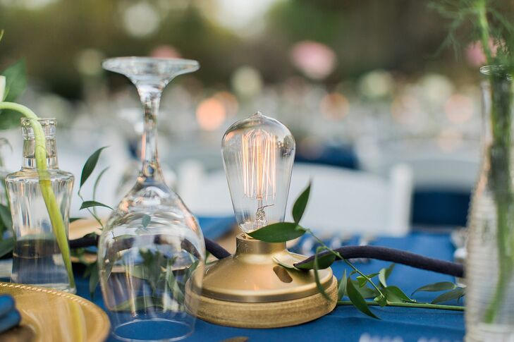 """Inspired by Pinterest, Patricia and two of the couple's co-workers made working strings of Edison bulbs for the reception. Each light lined the couple's family-style tables with a unique touch. """"These by far were the most incredible decoration we had,"""" Patricia says."""