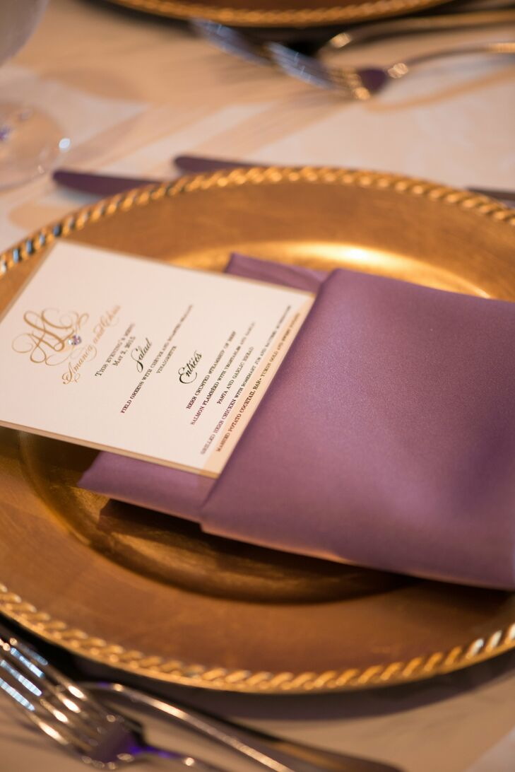 An ivory menu with gold script waited at each guest's place setting, folded into a lavender napkin atop a gold charger.
