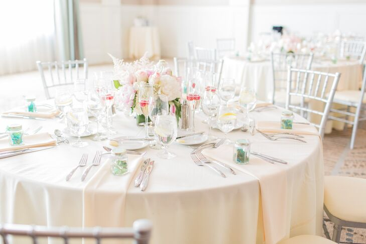 F As in Flowers took care of all of the couple's botanical needs, creating full, romantic arrangements of pale pastel blooms for each of the tables. Peonies, one of Gina's favorite flowers, featured prominently in the centerpieces, bring a cheerful spring-inspired quality to the chic modern space.