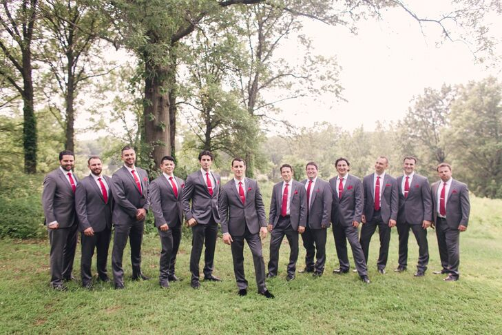 The groomsmen wore dark gray suits, red ties, pocket squares and tie clips. Nicole gifted the groom black velvet slippers as well.