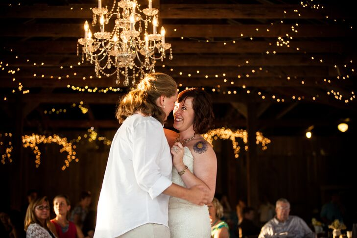 After the ceremony, the newlyweds and their guests headed to the open-air barn for a night of dinner and dancing. Strands of fairy lights and decadent crystal chandeliers hung from the rafters of the Weston Red Barn, illuminating the dance floor and casting an ambient glow over the cozy, rustic space.