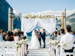 Wedding Arch Draped in Romantic Fabric and Garden Roses