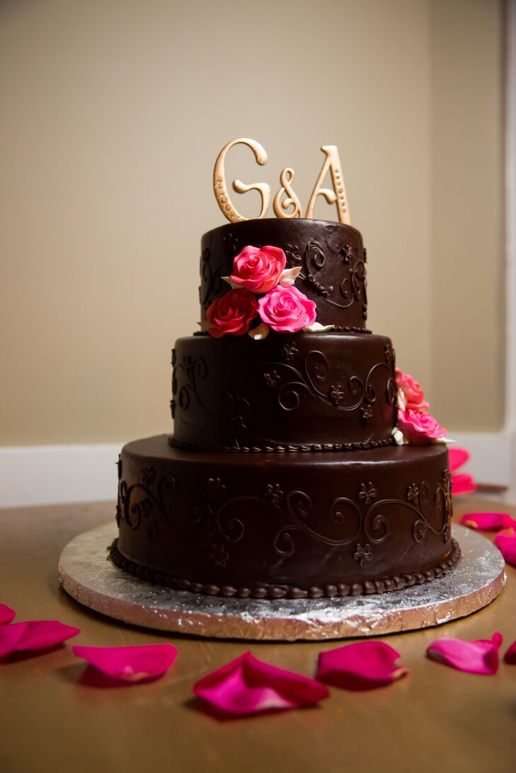 The couple opted for a dark chocolate cake with cherry preserves, frosted with chocolate ganache. Each piece was served with fresh berries and was a huge hit with guests.