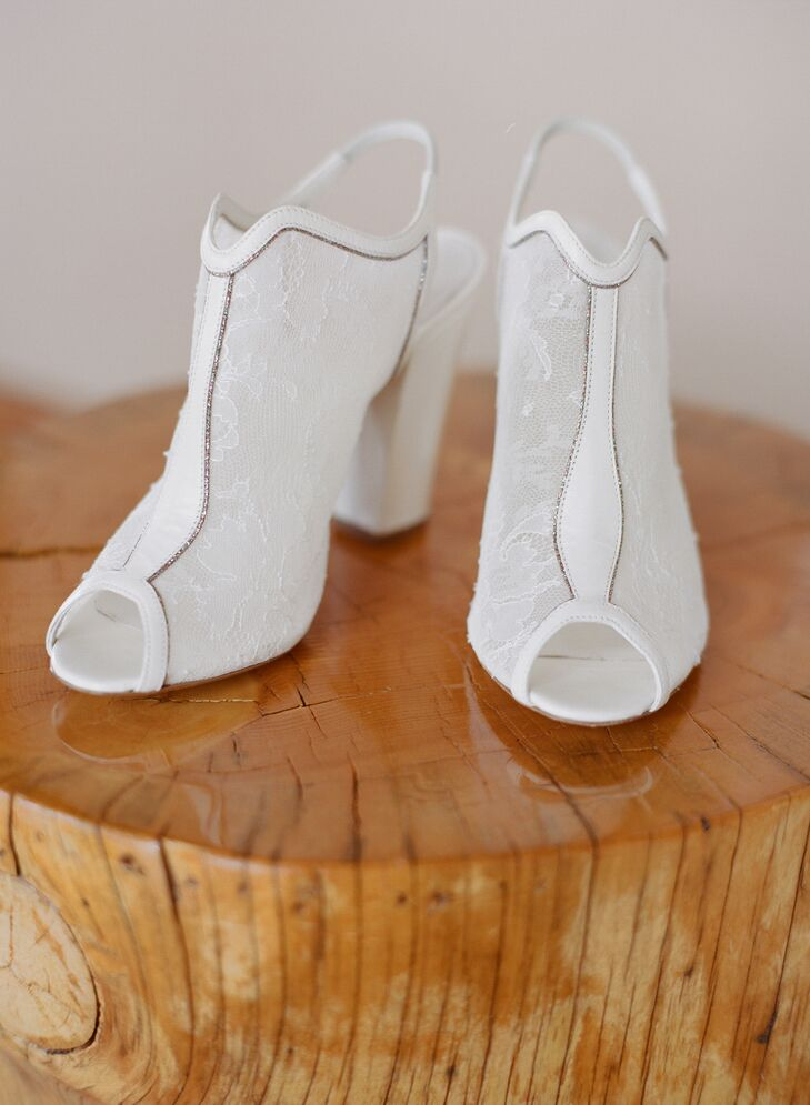 "Instead of going with a traditional heel to pair with her wedding gown, Katie sported a pair of white lace open toed booties with a wedge heel by Nicholas Kirkwood. ""They sound funky, but they were perfect and so comfortable,"" she says."