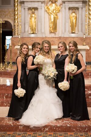 Bride with Bridesmaids in Black Dresses inside Church