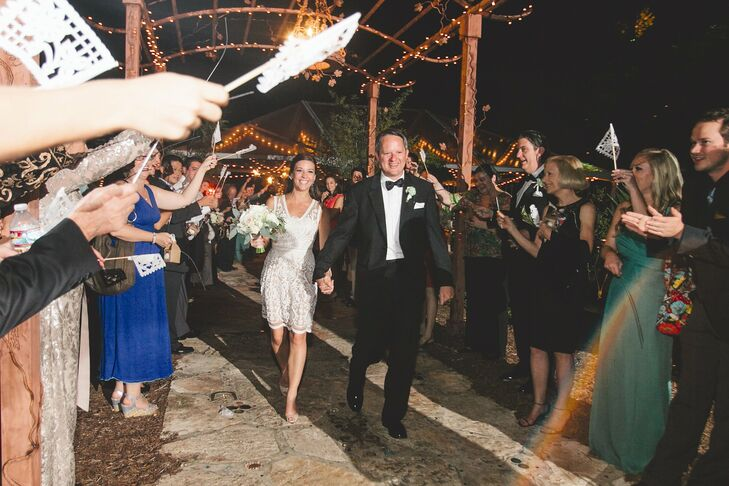 "Toward the end of the night, Celeste shed her gown in favor of a short getaway dress, which she paired with turquoise earrings. ""It was fun to change into something totally different from my wedding gown,"" she says."