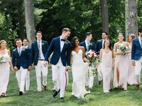 couple and wedding party walking together