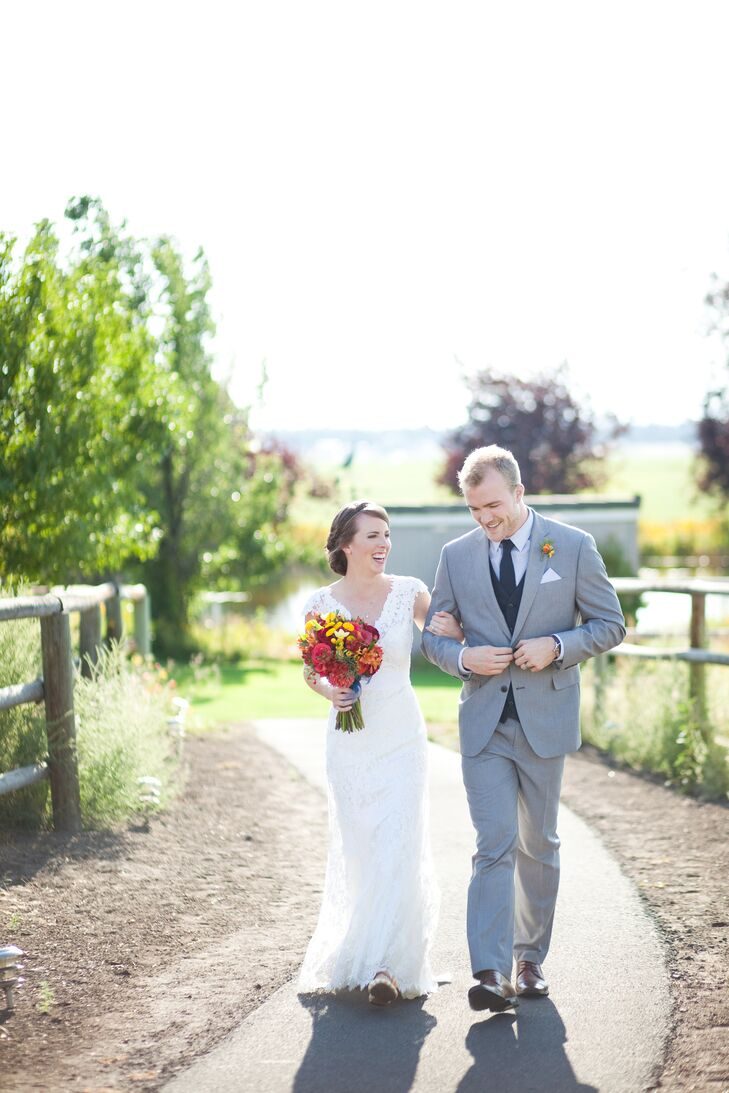 Kris walked with Sara down a path at K & K Garden View Estate, where their country, natural-style nuptials took place. Kris wore a light gray suit, paired with a navy blue tie and vest that followed the day's main hues.