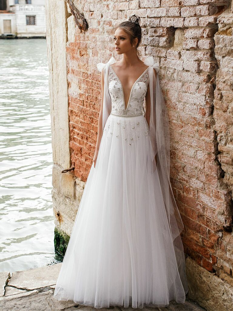 Julie Vino Spring 2018 sheer A-line wedding dress with plunging V-neck sleeveless bodice and tulle bows at the shoulder