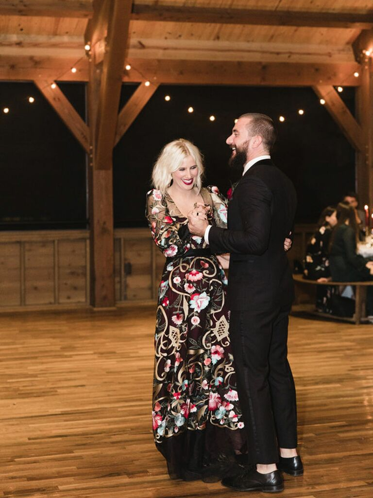 Edgy bride and groom dancing during first dance at wedding reception