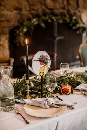 Dining Table with Candles, Greenery and Whimsical Bird Table Designation