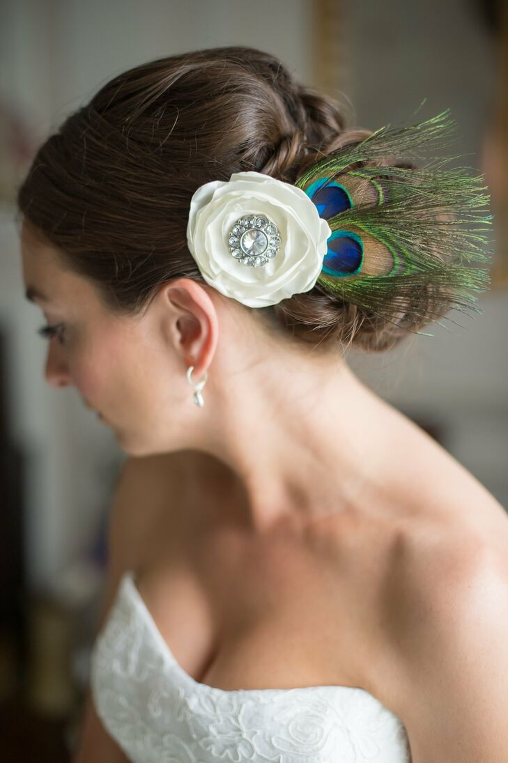 Kathryn wore her hair back in a curly low bun and had a hair piece that was made of a silk flower and peacock feathers.