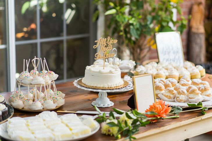 "While cake balls and petite sweets abounded, Samantha and Adam stuck with tradition and added a single-tier cutting cake to their impressive spread. The combed buttercream confection included an ""All You Need Is Love"" cake topper—the recessional song at the ceremony—for a hint of festive flair."