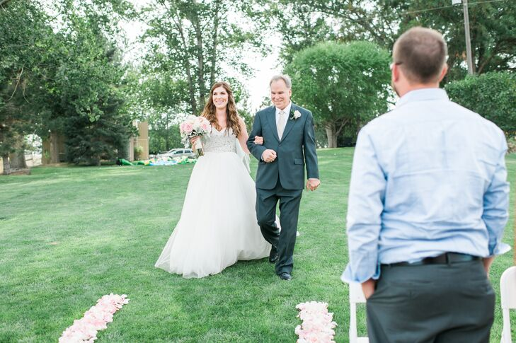"""I walked down the aisle to an instrumental version of 'A Thousand Years' [by Christina Perri],"" Amber says. ""The first time I'd heard that song, way before we were engaged, I knew it would be the song I walked down the aisle to."""